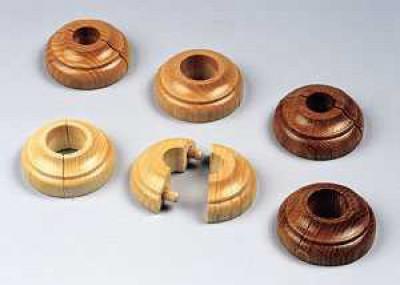 Кольца скрывают щели вокруг труб отопления