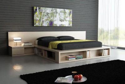 Многофункциональный подиум используется в качестве кровати, прикроватного столика, тумбочки и книжной полки