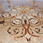 Розетка из глянцевого художественного ламината